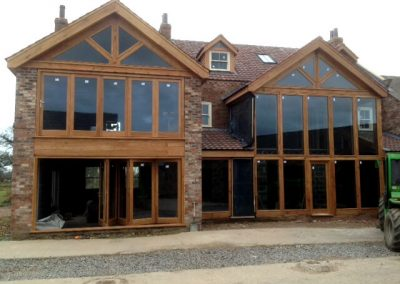 Oak Facades incorporating Bi-folding doors
