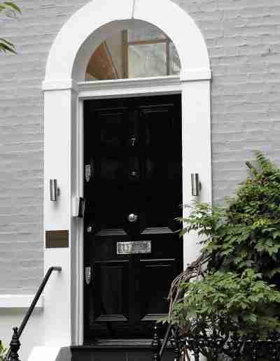 Black four panel townhouse door