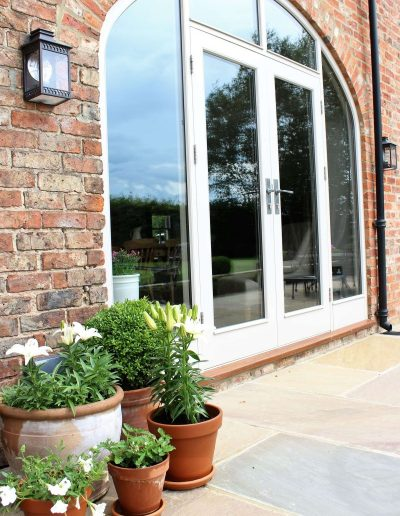 Arched Screen with French Doors