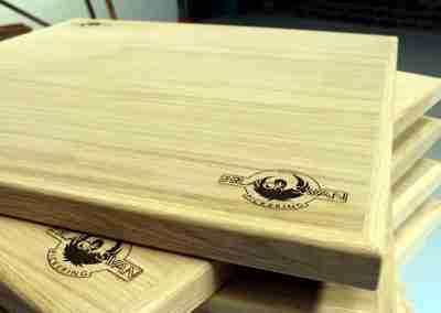 Laser engraved logo into oak table top