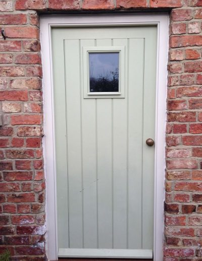 Boarded cottage door with glazed aperture