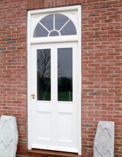 Factory painted wood door with radial storeylight
