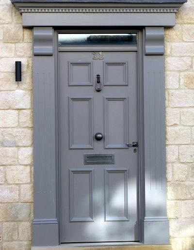 Panelled townhouse door with surround