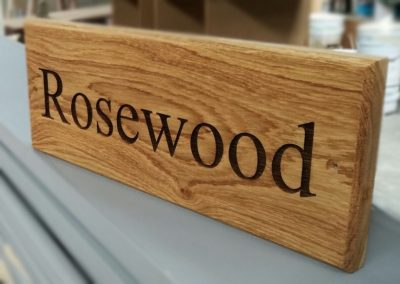 Personalised laser engraved house signs