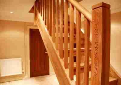 Oak stair with engraved newel