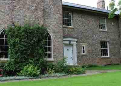 Box sash windows and Gothic arched windows