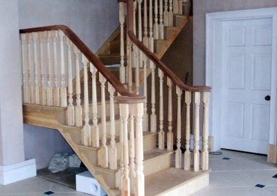 Stair with cut and mitred strings and continuous handrail