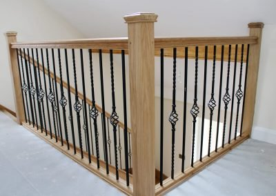 Oak stair balustrade with metal spindles