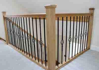 Oak stair balustrade with metal spindles