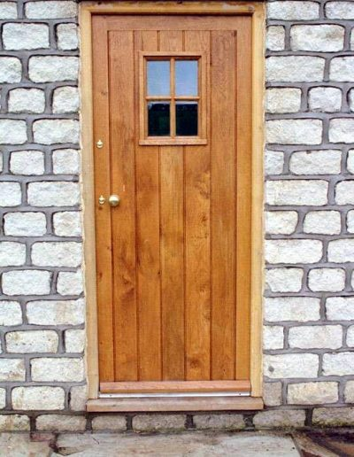 Oak boarded cottage door with glazed aperture