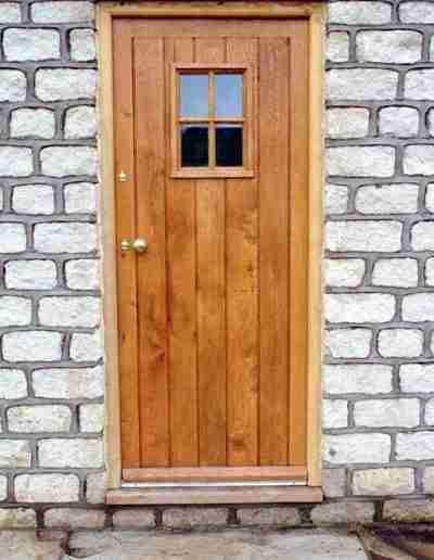 Oak boarded cottage door with glazed aperture