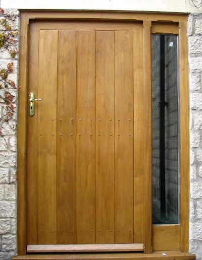 Oak boarded door and sidelight