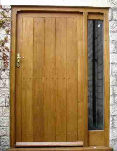 Oak boarded door and sidelight